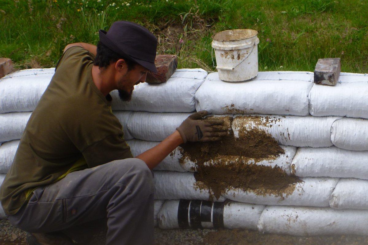 Applying Cob to Earthbags