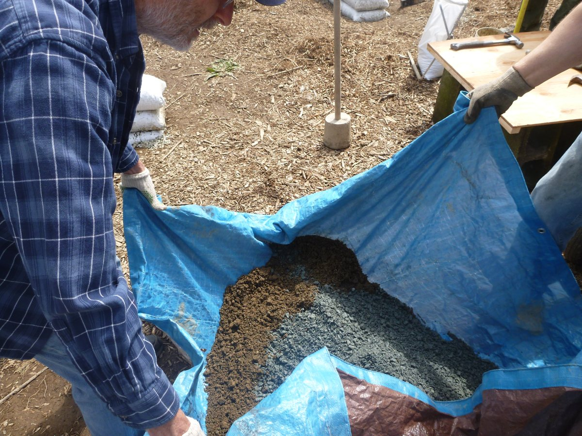 Mixing the earthbag fill of clay and gravel